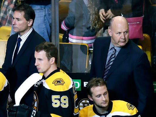FILE - In this Jan. 24, 2017 file photo, Boston Bruins head coach Claude Julien, right, stands with assistant head coach Bruce Cassidy, left, during the first period of an NHL hockey game in Boston. On Tuesday, Feb. 7, 2017, the Bruins fired Julien, who was in his 10th season as head coach, and named Cassidy interim coach. (AP Photo/Charles Krupa, File)