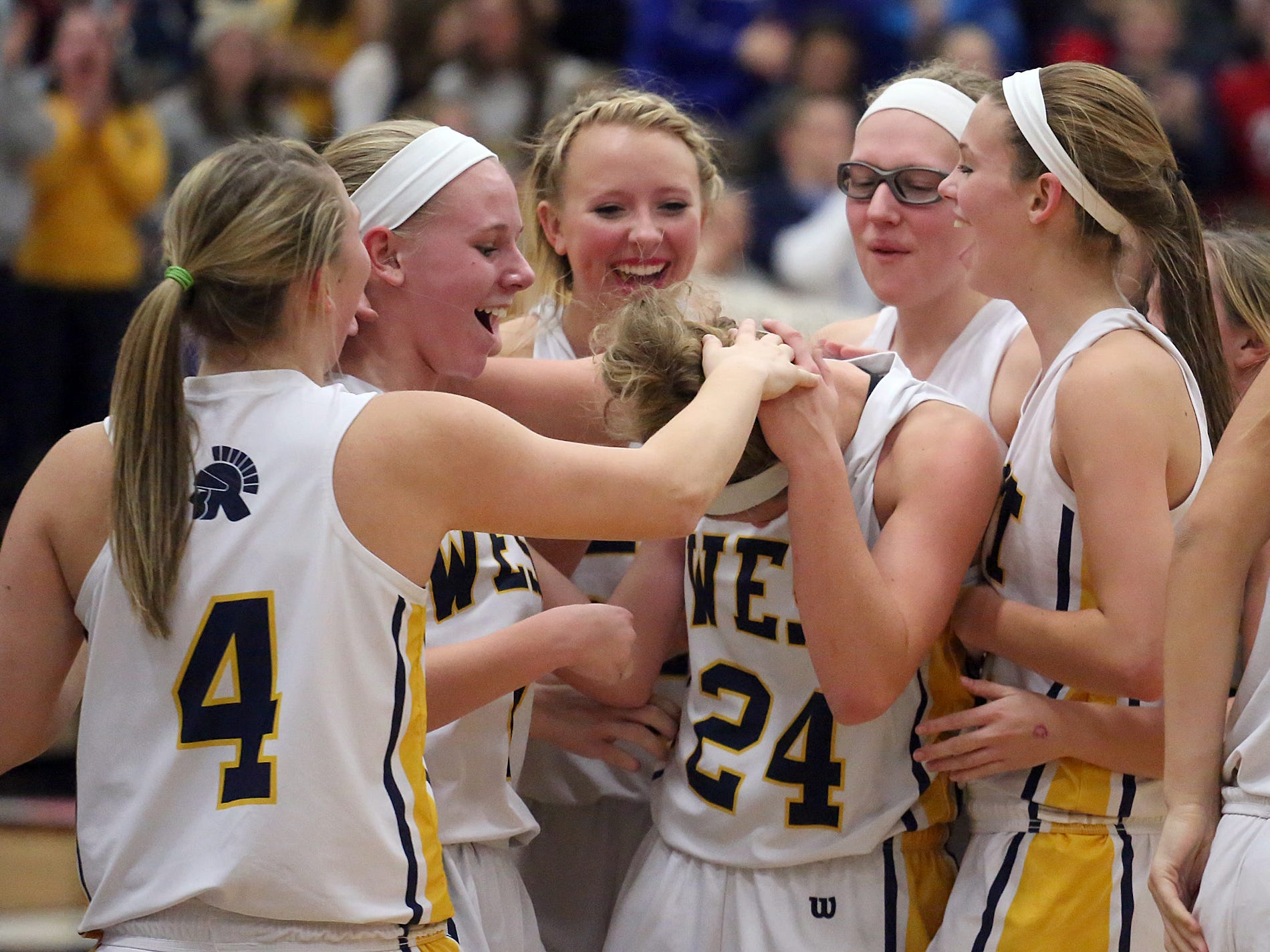 Wausau West's Jasmin Samz is congratulated after she scored her 1,000th career point as the Warriors lost to Pulaski on Friday.