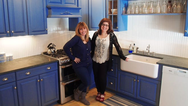 Claudia Weiger and Stacey Winnick. Weiger found almost everything she needed to update her kitchen at the Chappaqua Moms Group online tagsale site.