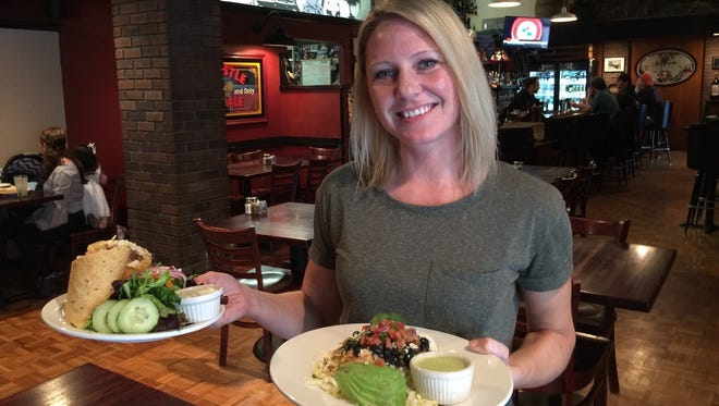 Server Heather Thompson with lunch orders at Market St. Steakhouse.