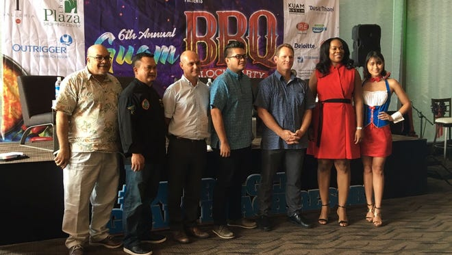 Panelists and guests for the sixth annual BBQ Block Party pose for a picture after a press conference on Tuesday, July 3, 2018.