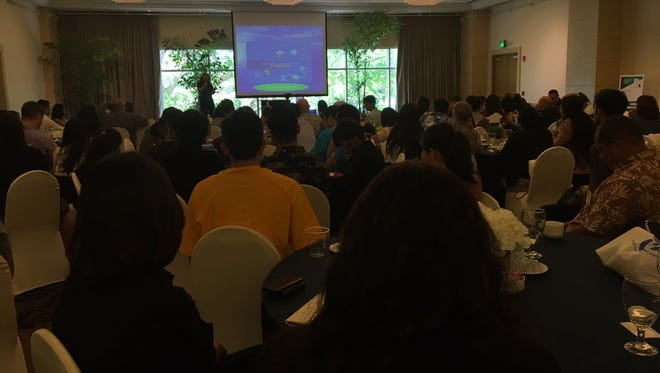 Audience members at Inspire Guam listen to Senior Business Adviser for Bank of Guam Denise Mendiola speak on entrepreneurship on Monday, July 8, 2018 at the Hilton Guam Resort & Spa.