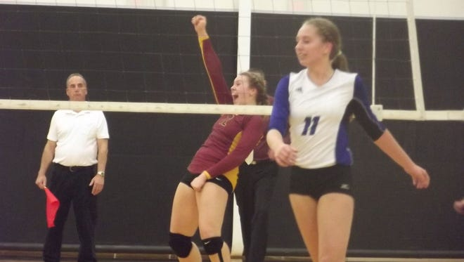 Luxemburg-Casco senior Maggie Liebeck celebrates a point in the fourth set of Thursday's WIAA Division 2 sectional semifinal volleyball match against Green Bay Notre Dame at Oconto Falls High School.