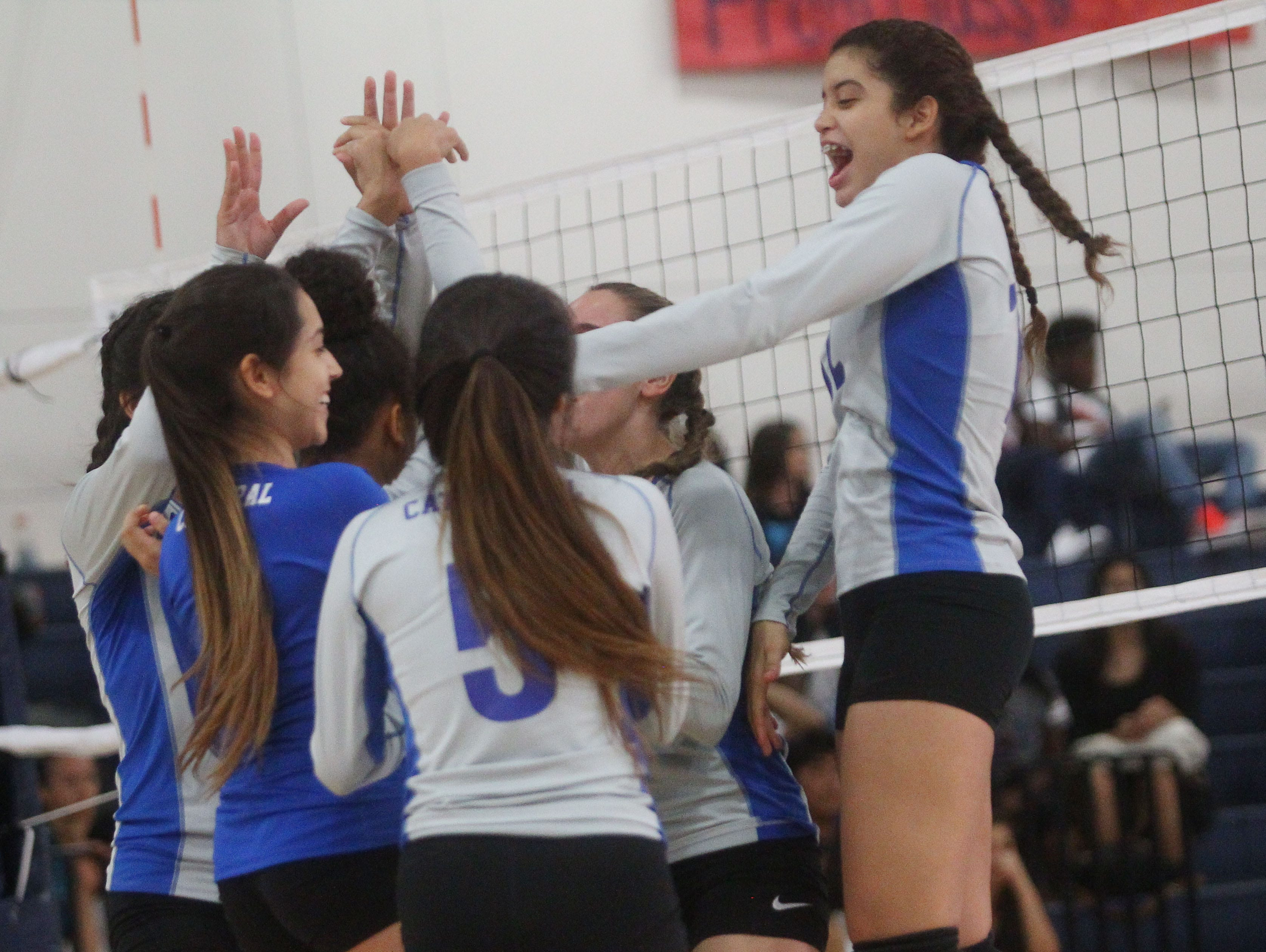 At far right, Cathedral City High School's Nia Chicas celebrates a point won against Desert Hot Springs with her team mates. Cathedral City won the match on the road.