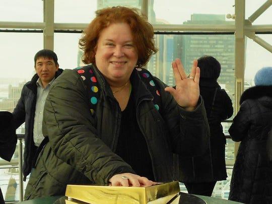 Lynette Ray at the top of the Baiterek monument in Astana, Kazakhstan.