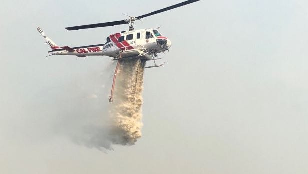 A helicopter attempts to put out the Euclid Fire on June 12, 2018.