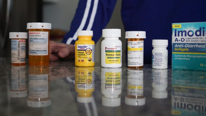 Steven Sipple, a former inmate at James T. Vaughn Correctional Center misdiagnosed with correctional center, shows off the multiple medications that he is taking while undergoing treatment for Stage 4 colorectal cancer.