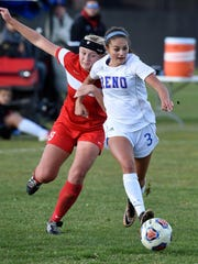 Wooster's Lauren Van Dorn, left, and Reno's Taylor Oliphant battle for the ball during Tuesday regional game at Reno High School onTuesday.