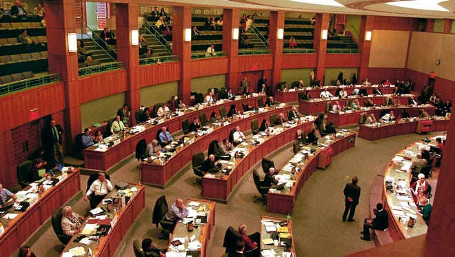 The state House prepares in 2013 to take votes that would send an immigrant driver's license bill out of committees and onto the House floor.