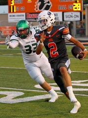 Westin Priddy tries to outrun Iowa Parks Steven Morrow Jr.  Friday night in Burkburnett as the Bulldogs hosted the Hawks in Friday night action.