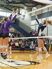 Gull Lake junior Kenzy Corstange, hits against Lakeview