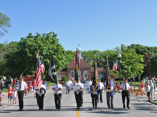 In this file photo, a Greendale veterans' color guard leads the Greendale Memorial Day Parade on Broad Street.