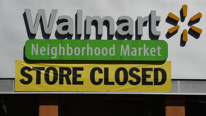 Walmart was among the companies reporting a drop in earnings in the fourth quarter.