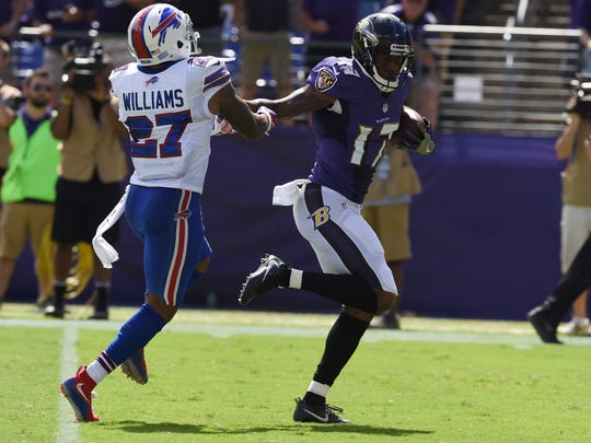 Mike Wallace of the Ravens burns Duke Williams for a 66-yard TD on opening day.