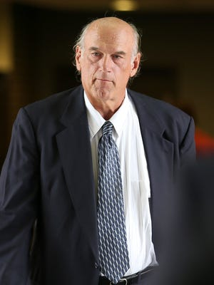 Former Minnesota Gov. Jesse Ventura, right, made his way back into Warren E. Burger Federal Building during the first day of jury selection in a defamation lawsuit on July 8, 2014 in St. Paul, Minn. Ventura filed the defamation lawsuit against the Chris Kyle estate, claiming that Kyle's account of a bar fight in a book he wrote was false.