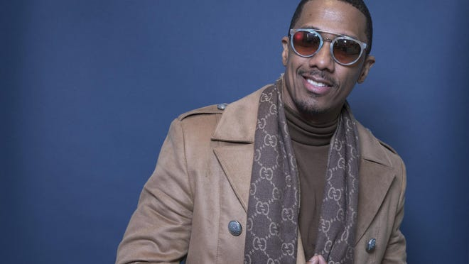 "FILE - In this Dec. 10, 2018, file photo Nick Cannon poses for a portrait in New York. Cannon's ""hateful speech"" and anti-Semitic conspiracy theories led ViacomCBS to cut ties with the performer, the media giant said. ""ViacomCBS condemns bigotry of any kind and we categorically denounce all forms of anti-Semitism,"" the company said in a statement Tuesday, July 14, 2020. It is terminating its relationship with Cannon, ViacomCBS said."