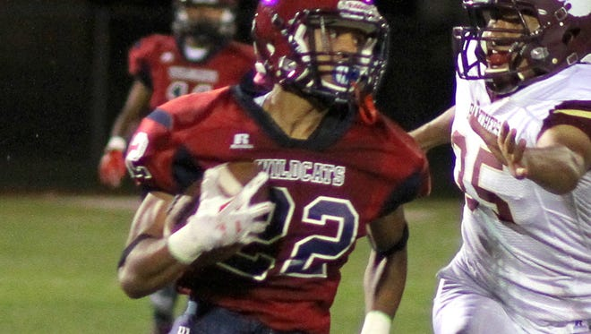 Junior back Cesar Chavez (22) sprints away from a Gadsden defender en route to a 99-yard kick return for a touchdown. Chavez and the Deming Wildcats ended a year-long drought with the program's first victory, 22-9  on Friday ay DHS Memorial Stadium.