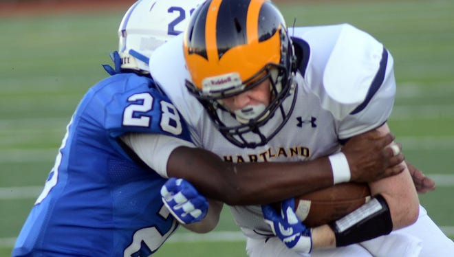 Evan Metz (right) and the Hartland football team dropped to 0-3 on Friday in a loss to Canton.