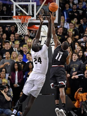 UCF Knights center Tacko Fall (24) and Cincinnati Bearcats forward Gary Clark (11) battle for a rebound during the first half at CFE Federal Credit Union Arena.