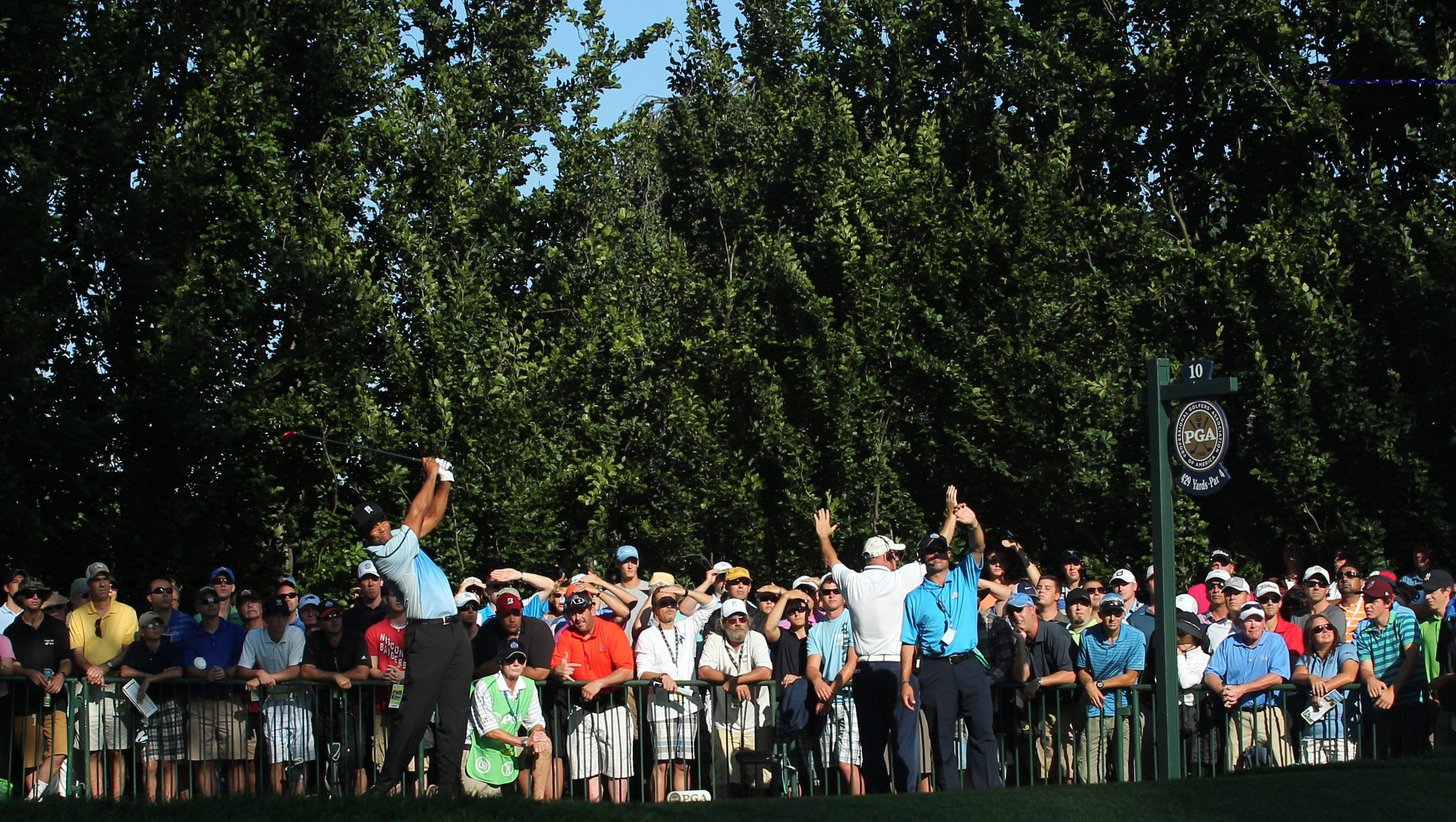 Tiger Woods tees off on the 10th hole during the first round of the 95th PGA Championship at Oak Hill Country Club.