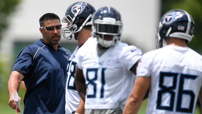 Titans head coach Mike Vrabel talks with tight end Luke Stocker (88) during practice at Saint Thomas Sports Park Tuesday, June 12, 2018, in Nashville , Tenn.