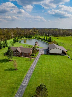 Located on Hidden Hills Drive in Centerville, Ind., this property listed at $429,900 includes three bedrooms, three bathrooms and 11 acres of land with a pond and gazebo. The interior incorporates woodwork through its cathedral ceilings.