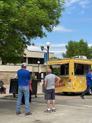 Here, people line up to place their orders over lunch in downtown Crookston.