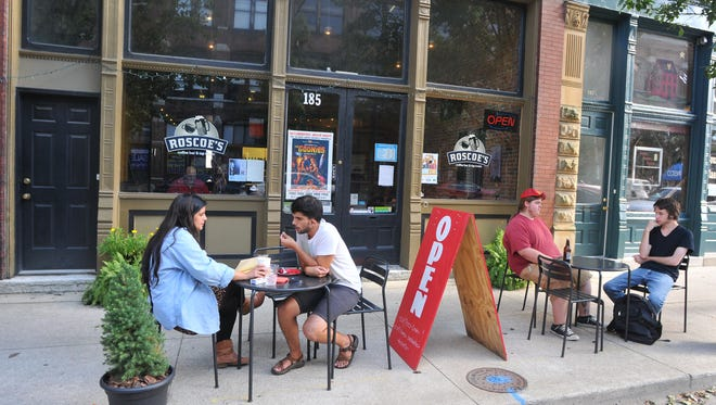 Customers dine outside at Roscoe's Coffee Bar and Tap Room.