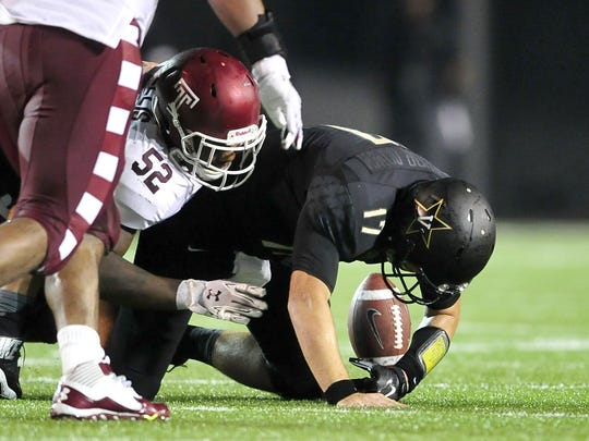 Vanderbilt quarterback Stephen Rivers (17) fumbles after being tackled by Temple's Avery Ellis during the second quarter Thursday.