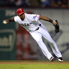 Sep 12, 2014; Arlington, TX, USA; Texas Rangers third baseman Adrian Beltre (29) throws to first base but is unable to get Atlanta Braves catcher Christian Bethancourt (not pictured) at Globe Life Park in Arlington. Texas beat Atlanta 2-1. Mandatory Credit: Tim Heitman-USA TODAY Sports