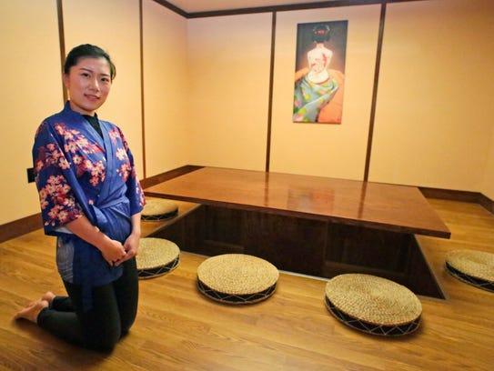 Umi Sushi and Steak House's Cynthia Li, kneels in the