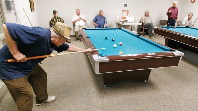 Seniors play pool at the St. George Senior Center, Wednesday, Feb. 25, 2015.