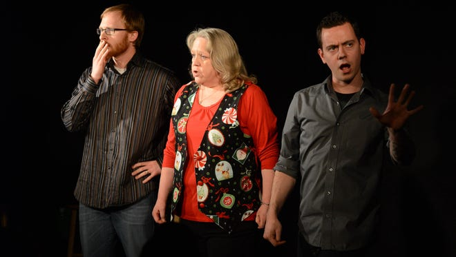 Dave Sundby (from left), Julie Harrison and Reverand Buerge perform improv at Capitol City Theater in 2013.