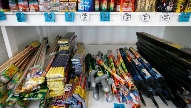 An assortment of fireworks on a shelf for sale at a Alamo Fireworks road side stand owned and operated by Dustin Shores.