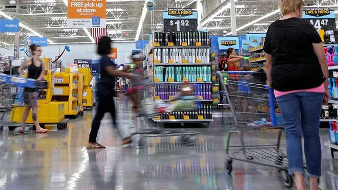Shoppers hunt for back-to-school items at the Walmart on Sawmill Road in Dublin during last year's state sales tax holiday.