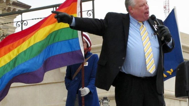 """Tom Witt of Equality Kansas, a gay-rights group, urges participants at a rally in Topeka on Tuesday to work to defeat conservative legislators behind a """"religious freedom"""" bill."""