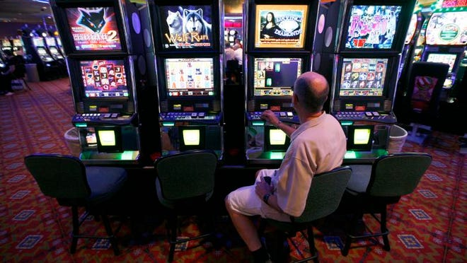 Lynn Port plays a slot machine at the Royal River Casino in Flandreau, S.D., Tuesday, June 28, 2011. The Flandreau Santee Sioux Tribe sued the state in 2007, saying the state refused to negotiate in good faith on a new tribal gaming compact. (Devin Wagner/Argus Leader)
