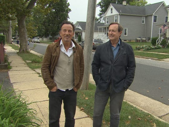 "Bruce Springsteen and Anthony Mason on Randolph Street in Freehold during a taping of CBS' ""Sunday Morning."""