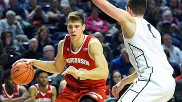 Wisconsin Badgers forward Ethan Happ (22) drives to the basket as Penn State Nittany Lions forward Deividas Zemgulis (1) defends during the second half at the Bryce Jordan Center. Wisconsin won 66-60.