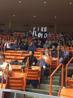 """A group of UTEP fans hold up a """"Fire Floyd"""" sign earlier this season during the Miners 12-game losing streak."""