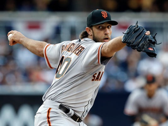 FILE - In this April 8, 2017, file photo, San Francisco Giants starting pitcher Madison Bumgarner throws to a San Diego Padres batter during the first inning of a baseball game in San Diego. Bumgarner returns to the mound Saturday for the first time since a dirt bike accident led to a sprained AC joint in his pitching shoulder and bruised ribs. (AP Photo/Alex Gallardo, File)