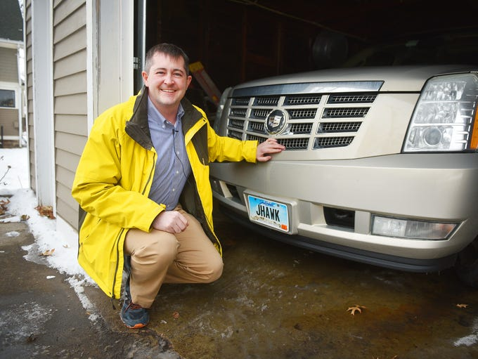 Matt Parker shows off his vanity license plate Tuesday,