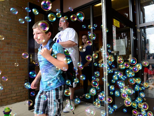 Bryce Estep is surrounded by bubbles as he leaves leaves