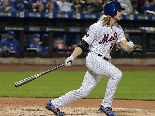 New York Mets' Noah Syndergaard (34) doubles to right field to drive in a run against the Toronto Blue Jays during the second inning of a baseball game, Tuesday, May 15, 2018, in New York.