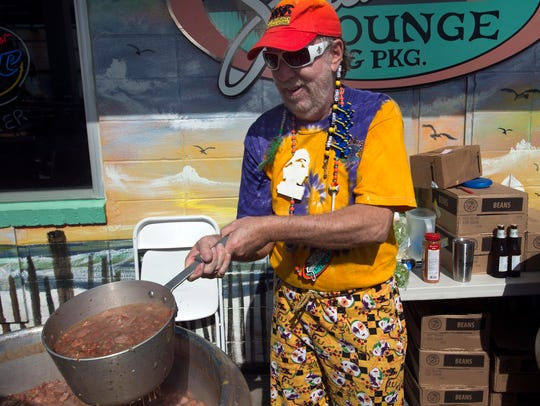 Tommy Grice prepares his signature red beans recipe for the 2017 Krewe of Wrecks Read Beans and Rice Luncheon. This year's event will be Monday at the Sandshaker.