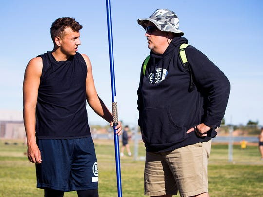 Kevin Fairchild, 17, left, a javelin thrower at Phoenix