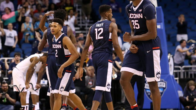 Connecticut Huskies center Amida Brimah (35) reacts after a play in the fourth overtime against the Cincinnati Bearcats during the AAC Tournament at the Amway Center. The Connecticut Huskies won 104-97.