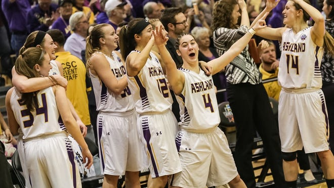 The Ashland University women's basketball team celebrates a Division II national championship.