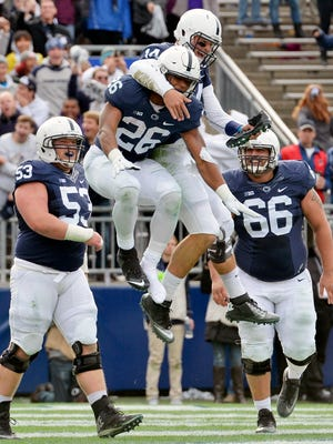 Penn State Nittany Lions running back Saquon Barkley (26) and quarterback Christian Hackenberg celebrate in the end zone during Penn State's 39-0 victory against Illinois on Oct. 31.