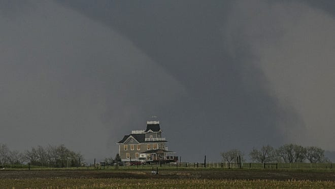 A tornado forms over a house near  Pilger, Neb., on June 16, 2014.